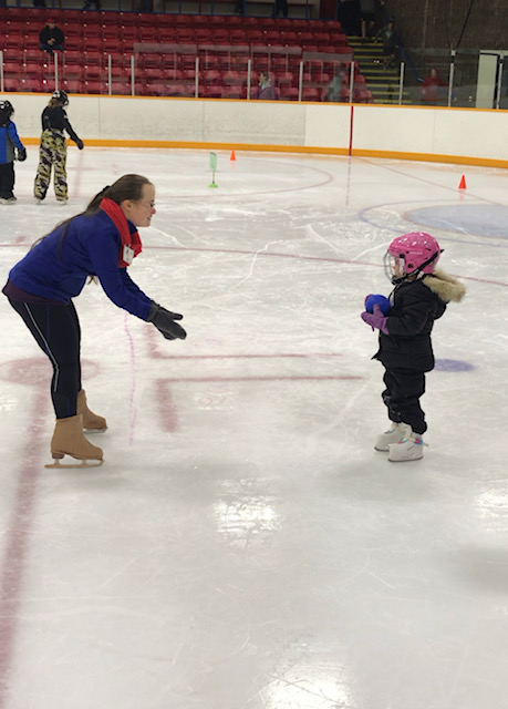 Julia volunteering with the CanSkate program