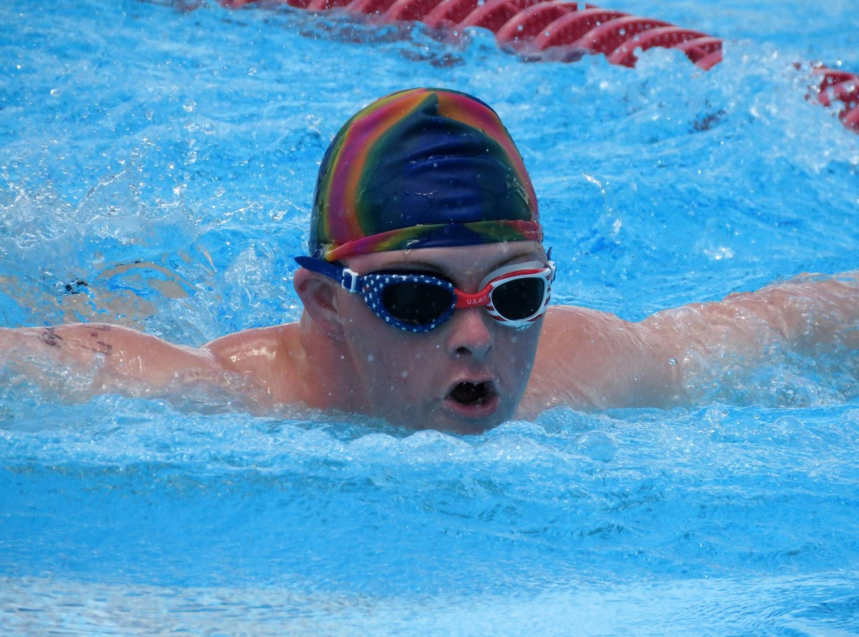 Stephen competes in swimming with Special Olympics