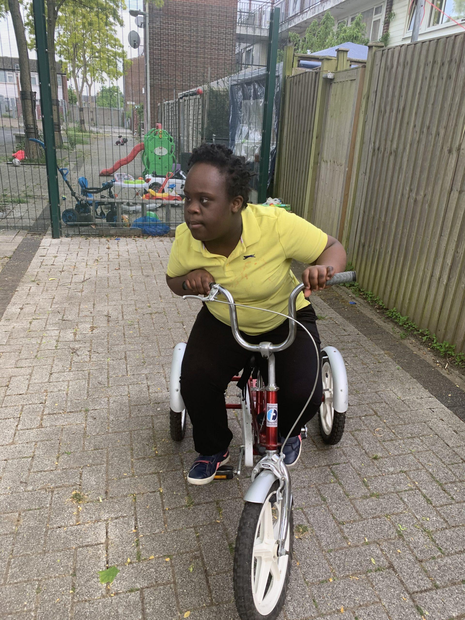 Shari rides her trike
